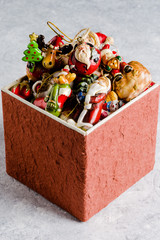 Little carton box with different Christmas decorations.