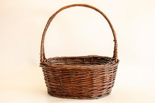 empty wicker basket on soft light background / copy space