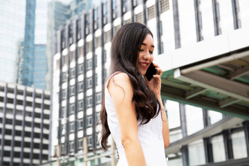 Beautiful woman smile portrait and talking mobile phone device. blur and retouch mobile phone device.