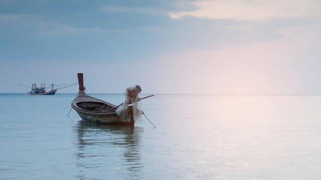 Small fishing boat parking on ocean skyline, natural landscape background