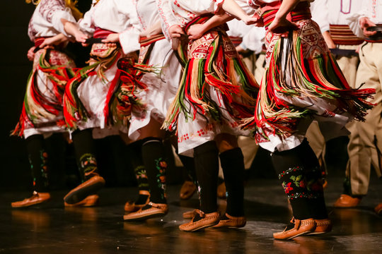 Young Serbian dancers in traditional costume. Folklore of Serbia