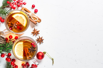 Photo sur Aluminium The Winter hot tea with fruit, berries and spices on white table.