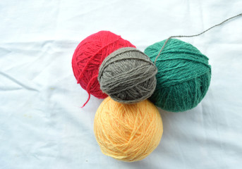 colored yarn for knitting on a light background