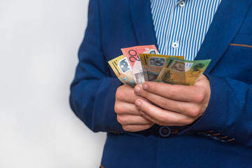 Male hands holding australias dollar banknotes closeup