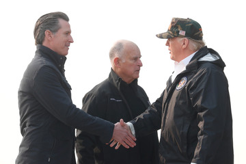 President Donald Trump shakes hands with Governor-elect Gavin Newsom upon arriving at Beale Air Force Base California