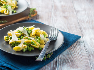 Italian orecchiette pasta with peas, cream and pecorino cheese