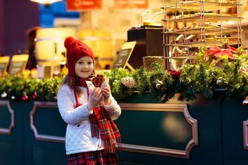 Kids at Christmas fair. Child at Xmas market.
