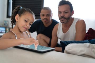 LGBTQ Family Using Digital Tablet