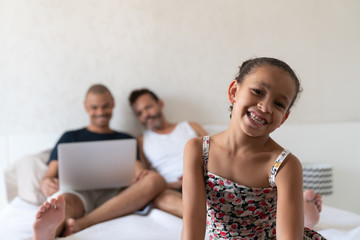 LGBTQ Family Using Laptop in the Bedroom