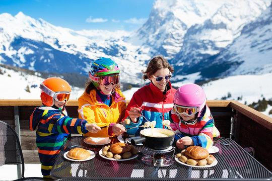 Family apres ski lunch in mountains. Skiing fun.