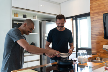Gay Couple Cooking at Home