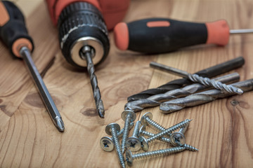 Close up Electric drill, Drill set, Screwdriver set. A set of home craftsmen for woodwork.