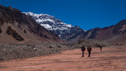 Group of tourists walking towards the south side of the Aconcagua mountain in the Aconcagua Provincial Park in the province of Mendoza in Argentina