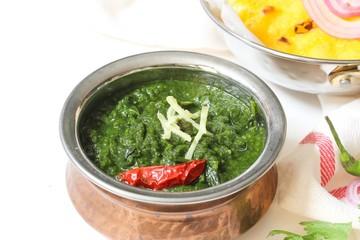 Sarson ka saag and Makki ki roti /Indian corn bread with mustard leaves gravy