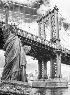 Statue of Liberty against Manhattan Bridge, New York. USA