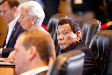 Philippines' President Rodrigo Duterte looks on during the retreat session of the APEC Summit in Port Moresby, Papua New Guine