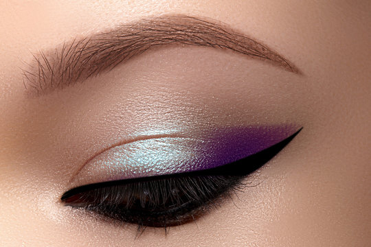 Celebrate Macro Eyes with Smoky Cat Eye Makeup. Cosmetics and Make-up. Closeup of Fashion Visage with Liner, Eyeshadows