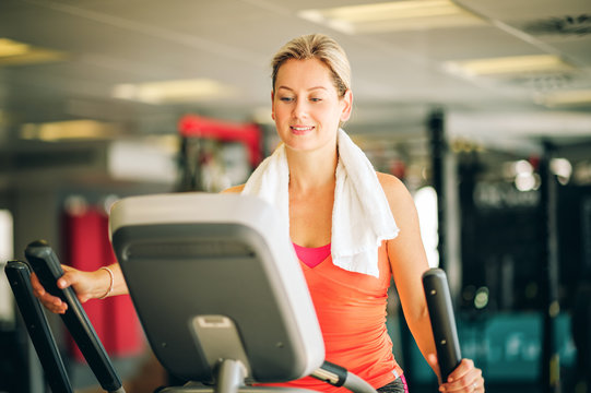 Young strong woman working out with stepper, sport and health lifestyle
