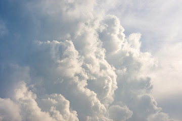 sky with clouds and sunlight closeup. Texture background, copy space