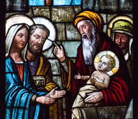 Casorate Primo, Italy. 2017/12/8. A stained glass window depicting Feast of the Presentation of Our Lord Jesus and the the Purification of the Blessed Virgin Mary in the church of San Vittore Martire.
