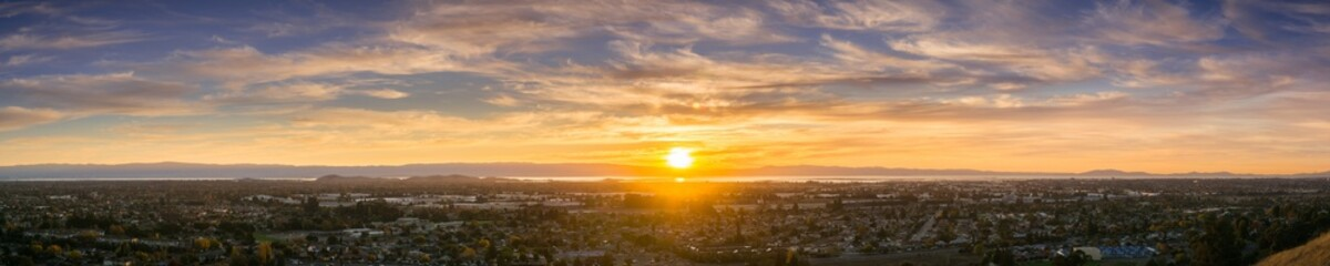 Expansive sunset panorama comprising the cities of east San Francisco bay, Fremont, Hayward and Union City, California Wall mural