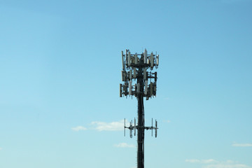 Communication pole line in blue sky