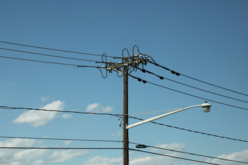 High electricity pole line in blue sky