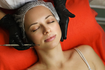 Hardware cosmetology. Beautician performs spot cleaning of face of young woman. Remove acne and skin pore cleansing. Anti-aging treatments. Spa salon.