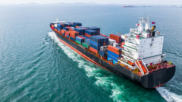Aerial view cargo container ship sailing, container cargo ship in import export and business logistic and transportation of international by container ship, view from above business background.