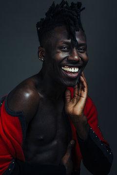 studio portrait of a man smiling at camera
