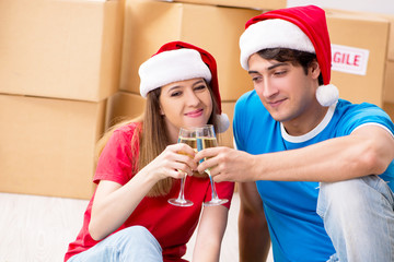 Young family celebrating christmas in new home