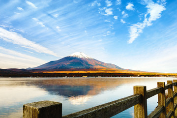 Beautiful Mount Fuji with colorful autumn with fence and footpath at Lake Yamanakako landmark in Japan.