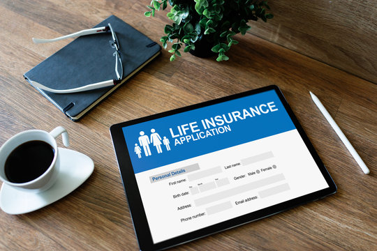 Life insurance online application form on device screen.