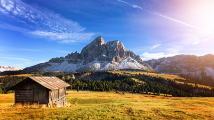 Mountain hut with beautiful peak on the background at passo Erbe, Dolomites, Italy Wall mural