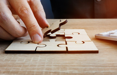 Business success and problem solving. Man holds piece of puzzle.
