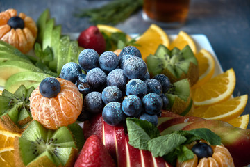 fruit plate. Glass bank of lemonade with sliced citrus fruits on a buffet table