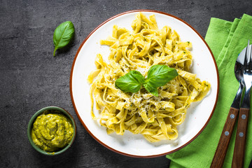Tagliatelle pasta with pesto sauce and parmesan.