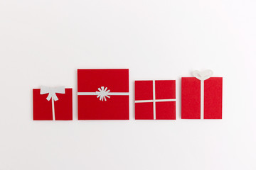 Four red paper-cut christmas gifts on white background