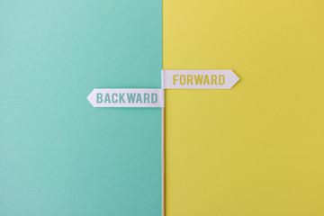 Two arrows showing in opposite directions: Forward vs backward