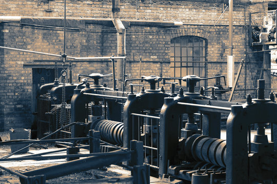 Victorian machine workshop factory with metal press machines with colour toning