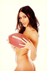 Beautiful nude woman holding american football ball.