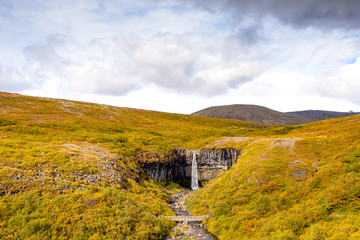 Beautiful sunny view of a waterfall falling from beautiful rocks. One of the most famous waterfalls in Iceland