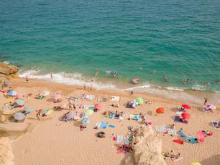 People at beach in Calella city. Spain.
