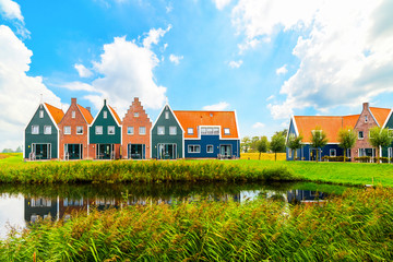 Fototapeta Volendam is a town in North Holland in the Netherlands. Colored houses of marine park in Volendam. North Holland, Netherlands..