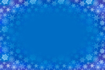 A lot of frozen snowflakes on blue winter background with text place