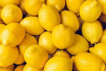 Ripe Yellow Lemons Close-up Background Or Texture. Lemon Harvest, Many Yellow Lemons. Fototapete