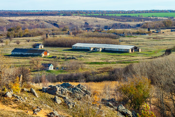 The group of abandoned old farm buildings in the stony grassland at the late autumn time. The decline in agriculture. Rostov-on-Don region, Russia