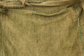 The texture of fiber of a sack khaki coloured.
