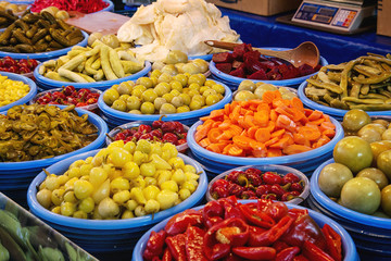 Turkish farmer market. Pickled vegetables peppers, olives, carrots, cucumbers on the counter
