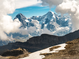 Landscape of snow mountain with cloudy sky in the swiss alps